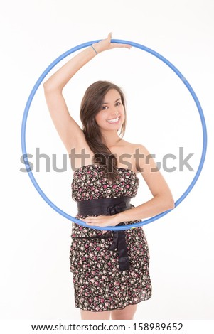 Portrait of a young woman near the beach with her hoop. - stock photo