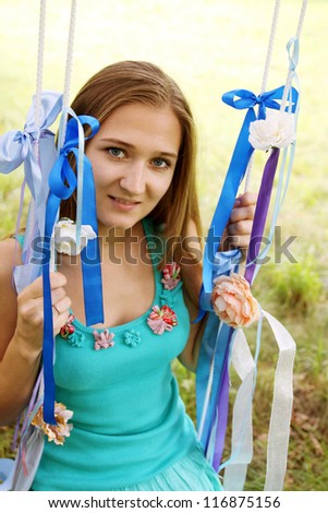 Portrait of a young woman on a swing - stock photo