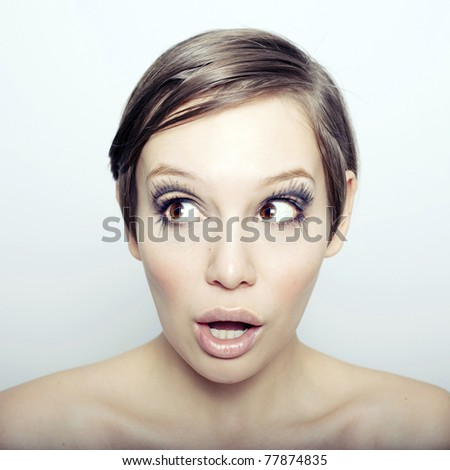 Portrait of a young woman on a white background. - stock photo