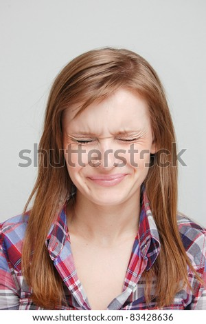portrait of a young woman on gray - stock photo