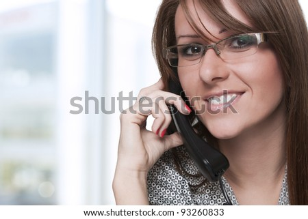 Portrait of a young woman on phone - stock photo