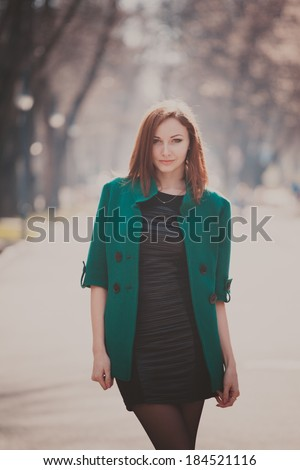 Portrait of a young woman on the streets of old city - stock photo