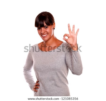 Portrait of a young woman saying you great job with her hand standing on isolated background - stock photo