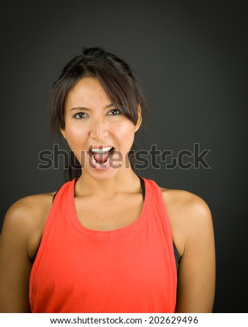 Portrait of a young woman shouting in excitement - stock photo