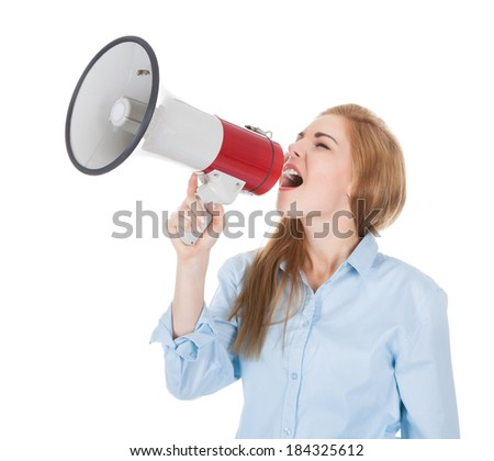 Portrait Of A Young Woman Shouting Through Megaphone Over White Background