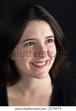 Portrait of a young woman smiling and looking slightly away from the camera.