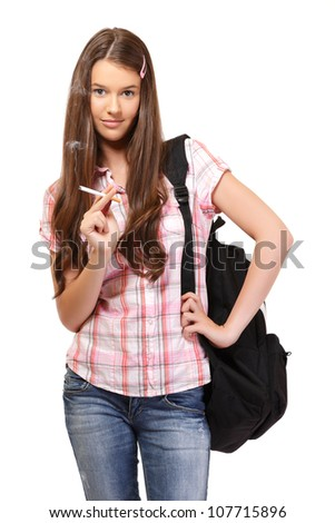 portrait of a young woman smoking - stock photo