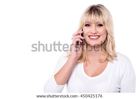 Portrait of a young woman talking on mobile phone.