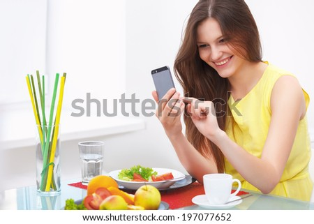Portrait of a Young Woman Talking on Mobile Phone at Home - stock photo
