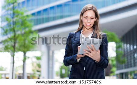Portrait of a young woman using a tablet - stock photo