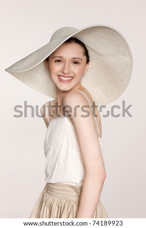 Portrait of a young woman wearing a broad brimmed hat