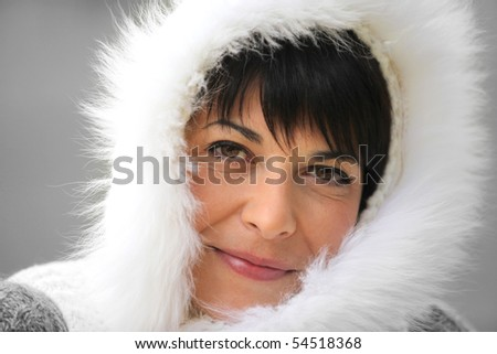 Portrait of a young woman wearing a hood - stock photo