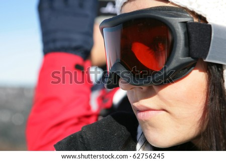 Portrait of a young woman wearing a mask of ski - stock photo