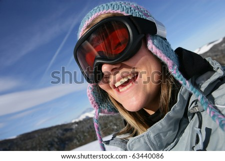 Portrait of a young woman wearing a mask of ski