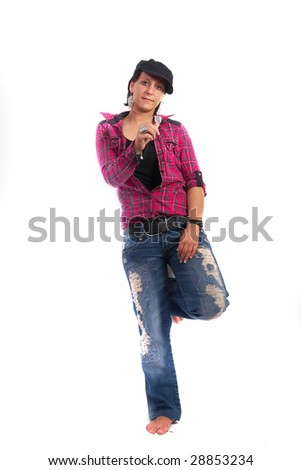 Portrait of a young woman wearing a pink shirt and ripped blue jeans. She is showing a key!