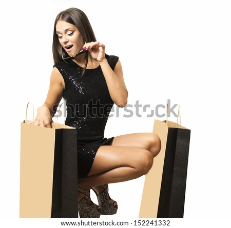 Portrait of a young woman who returns from shopping  - stock photo