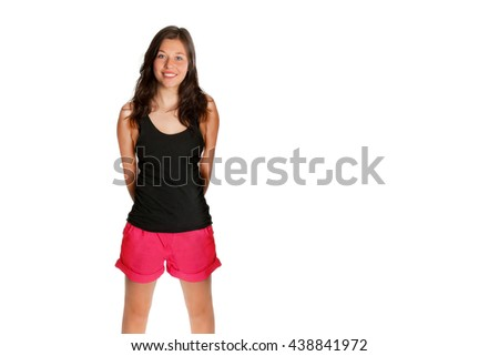 Portrait of a young woman with a beautiful smiling face, she's wearing red shorts and a black shirt in front of white studio background, photo with copy space on the right side of the image  - stock photo