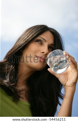 Portrait of a young woman with a glass of water - stock photo