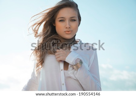 portrait of a young woman with a lovely look and bright make up. horizontal shot - stock photo