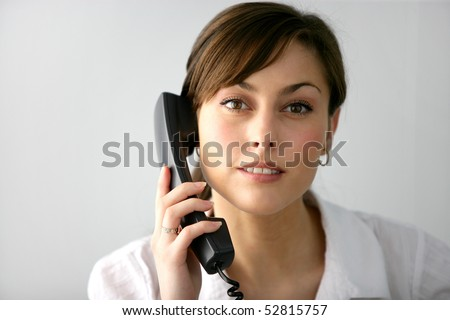 Portrait of a young woman with a phone - stock photo