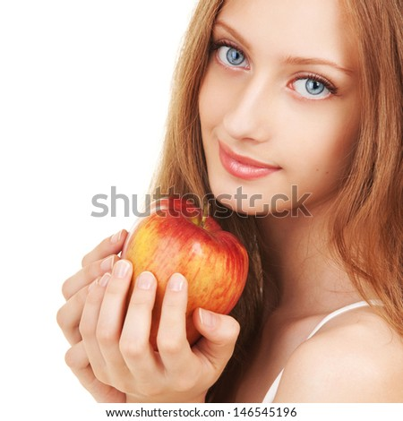 Portrait of a young woman with apple - stock photo