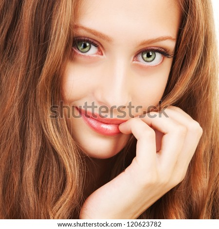 Portrait of a young woman with beautiful hair and green eyes - stock photo