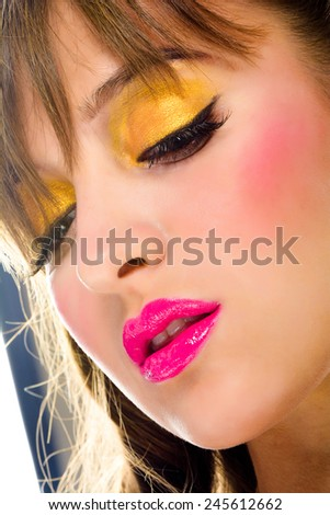 Portrait of a young woman with beautiful makeup - stock photo