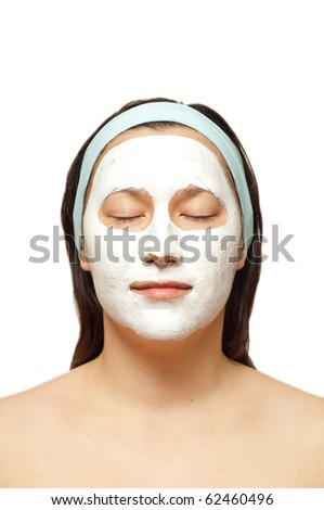 portrait of a young woman with beauty mask on her face isolated. Eyes closed - stock photo