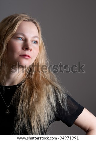 Portrait of a young woman with blue eyes and long hair. - stock photo