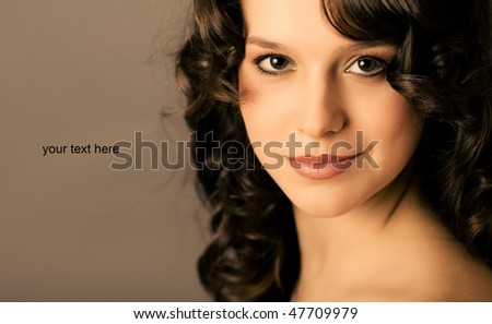 portrait of a young woman with curly hair - stock photo