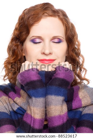 Portrait of a young woman with eyes closed in winter clothes - stock photo