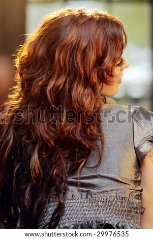 Portrait of a young woman with healthy raven hair - stock photo