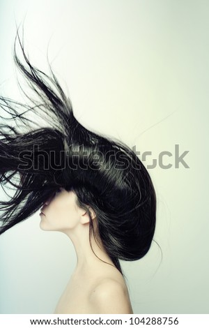 Portrait of a young woman with long black hair in profile - stock photo