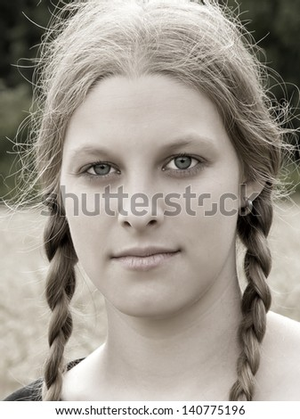 Portrait of a young woman with pigtails - stock photo