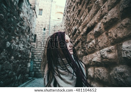 Portrait of a  young woman with pink dreadlocks in Old Jerusalem
