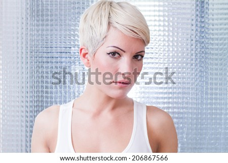 portrait of a young woman with short blond hair - stock photo