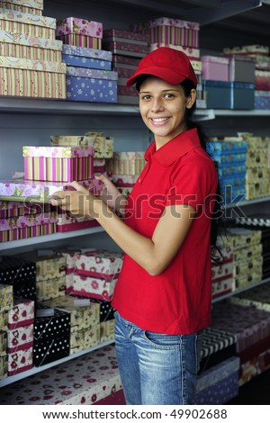 portrait of a young woman working as sales clerk in a store - stock photo