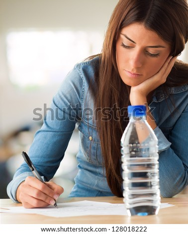 Portrait Of A Young Woman Writing On White Background - stock photo