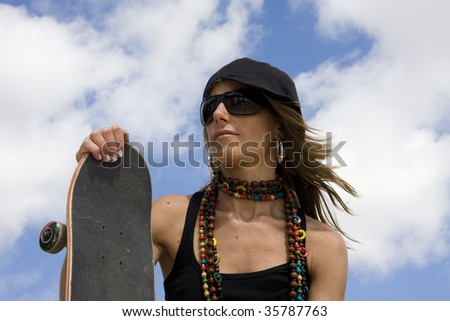 Portrait of a young women holding a skate - stock photo