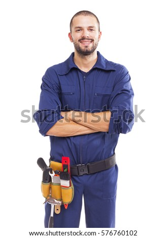 Portrait of a young worker smiling with arms crossed, isolated on white backround