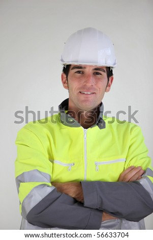 Portrait of a young worker with safety helmet - stock photo