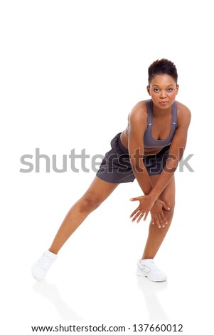 portrait of active african woman dancing isolated on white background - stock photo