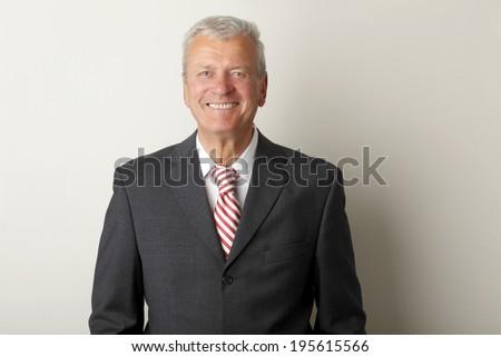 Portrait of active senior businessman smiling.  - stock photo