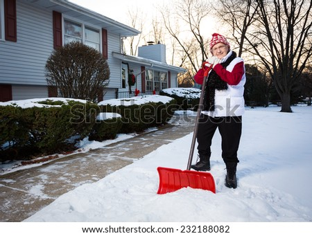 Portrait of Active Senior Citizen with Snow Shovel (Wide Perspective Showing More of Sidewalk) - stock photo