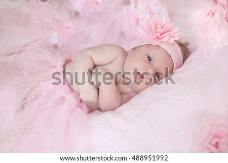 Portrait of adorable baby girl over pink, infant child.
