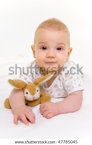 portrait of adorable baby with bunny on white background