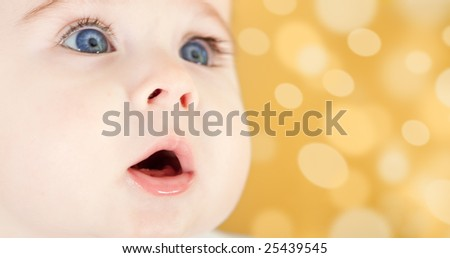 Portrait of adorable blue-eyes baby. Face close-up - stock photo