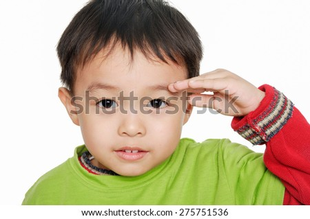 Portrait of adorable boy doing a military - stock photo