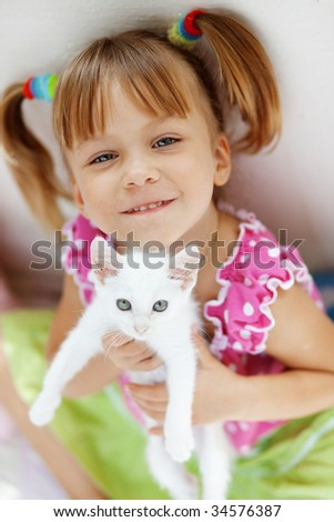 Portrait of adorable child with kitten - stock photo