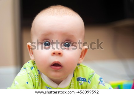 Portrait of adorable curious baby girl close up - stock photo
